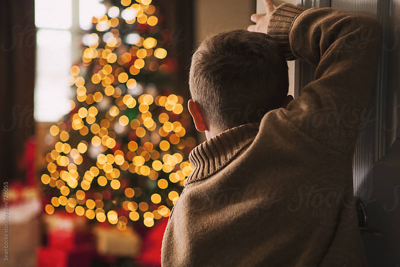 Christmas: Young Boy Waiting For Christmas Morning by Sean Locke for Stocksy United