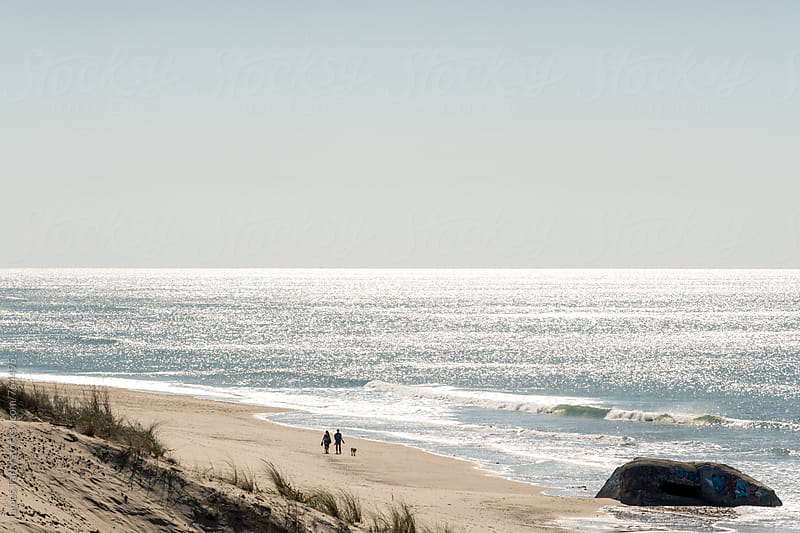 French beach and German Bunkers by James Tarry for Stocksy United