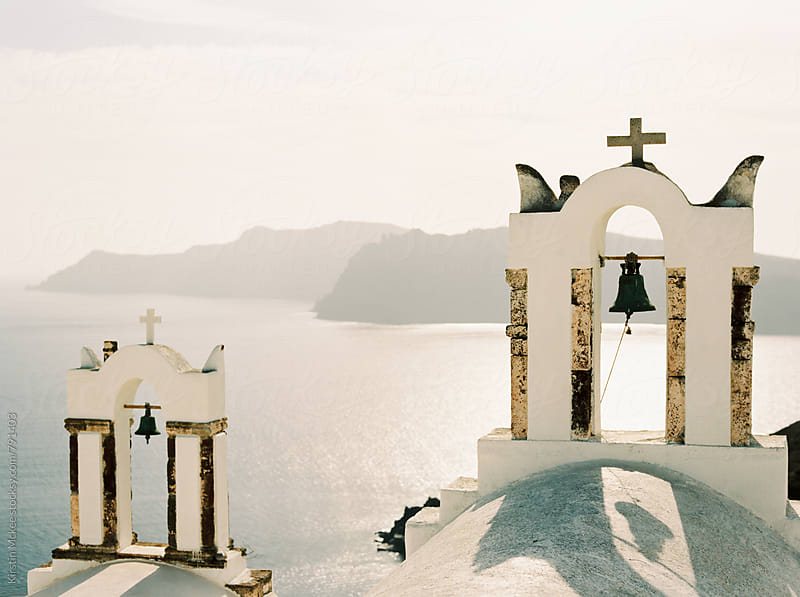 Two church bells and view of the sea, Santorini by Kirstin Mckee for Stocksy United