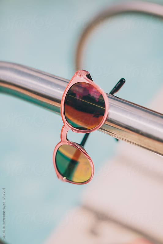 Sunglasses by a Pool by Gabrielle Lutze for Stocksy United