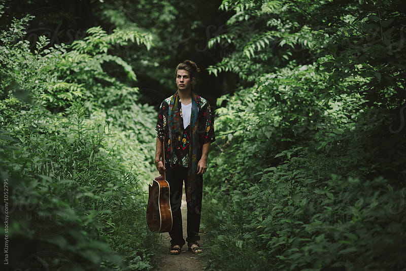 Young Man in the woods by Lina Kiznyte for Stocksy United