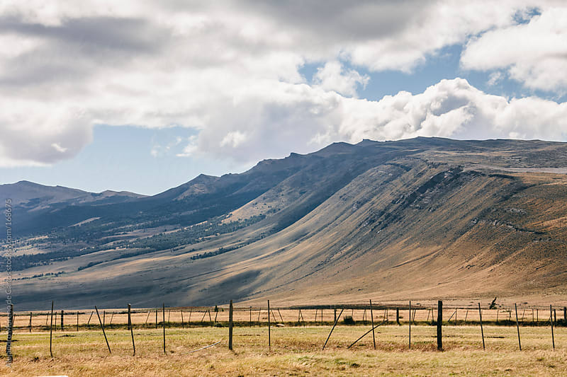 Mountains and clouds on countryside, Argentina, Patagonia by Alejandro Moreno de Carlos for Stocksy United