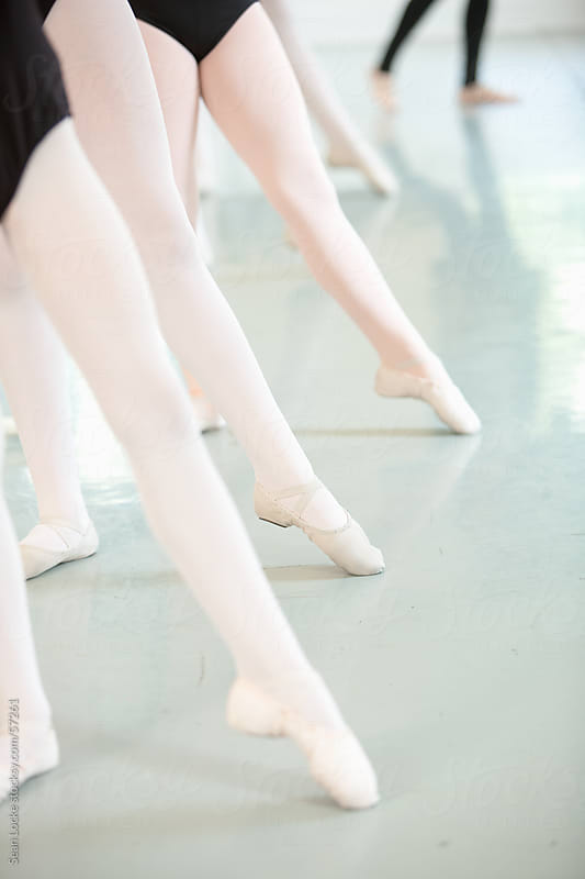 Ballet: Students Stretching Legs in Class by Sean Locke for Stocksy United