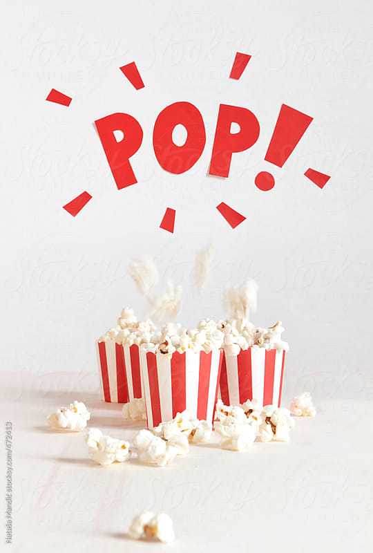 Small paper bucket with pop corn by Nataša Mandić for Stocksy United