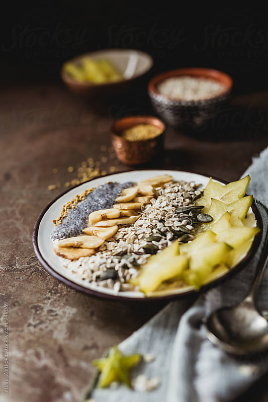 Muesli with carambola, seeds, dried banana and pollen by Tatjana Zlatkovic for Stocksy United