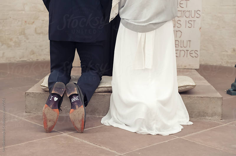 Marriage - Love wedding promise on man's sole of a shoe by Urs Siedentop & Co for Stocksy United