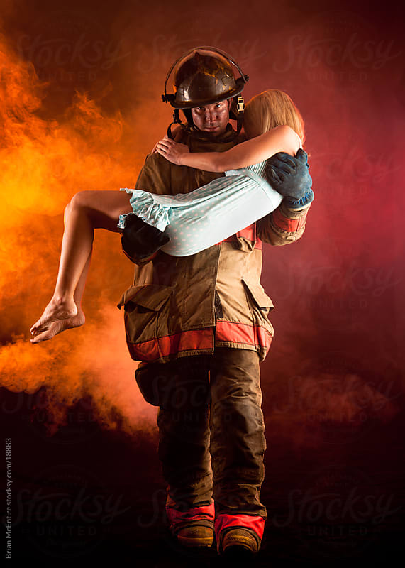 Fireman Carrying Woman From Buring Building by Brian McEntire for Stocksy United