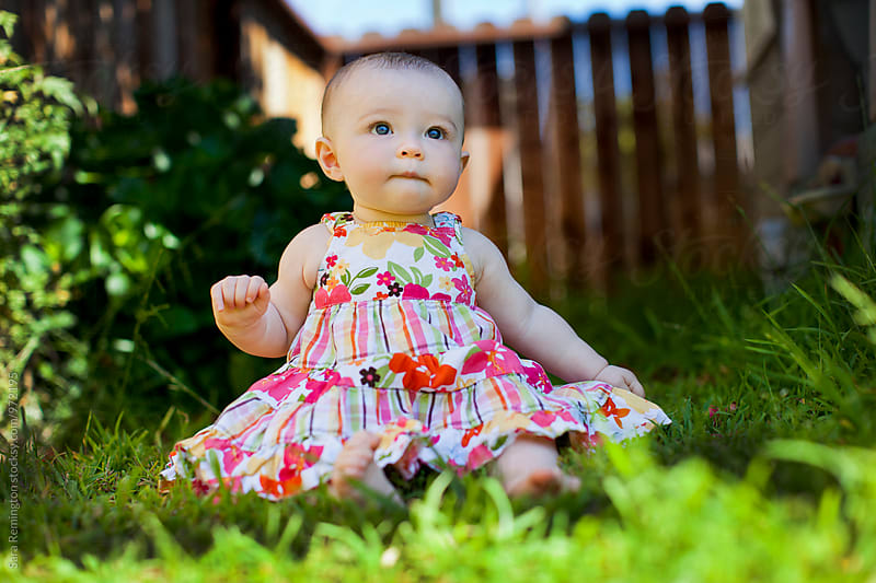 Baby Girl In Green Grass by Sara Remington for Stocksy United
