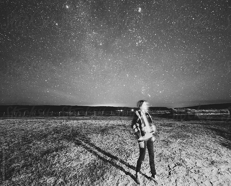 Woman In Field Under Stars by Evan Dalen for Stocksy United
