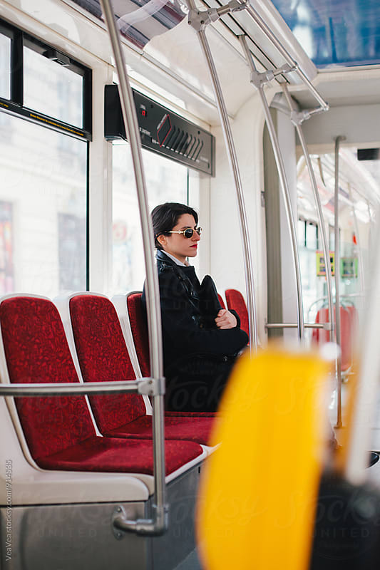Woman in a tram by VeaVea for Stocksy United