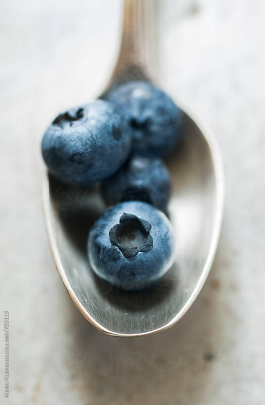 Blueberries with  silver spoon  by Alexey Kuzma for Stocksy United