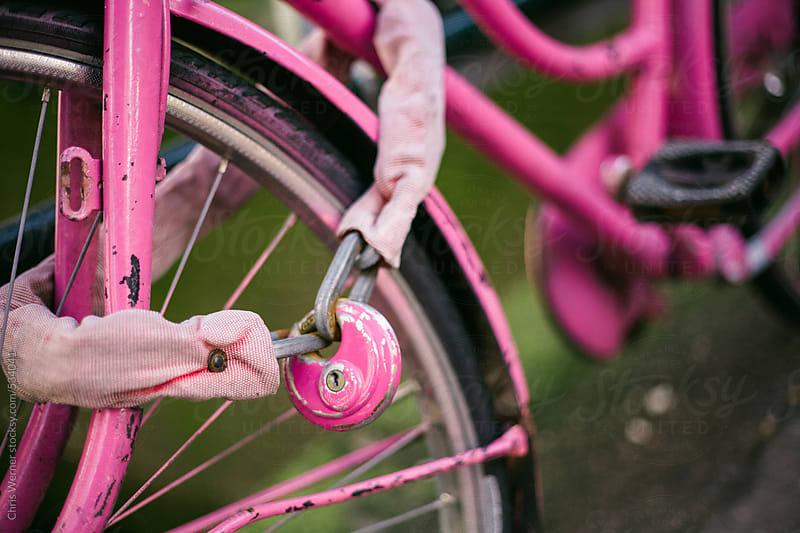 Pink bike lock and bike frame. by Chris Werner for Stocksy United