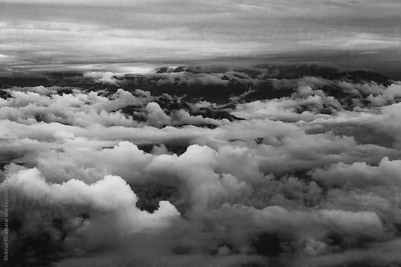 Dense clouds in the himalayas. by Shikhar Bhattarai for Stocksy United