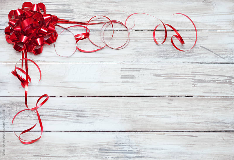 Ribbon: Red Ribbon And Bow On Wooden Background by Sean Locke for Stocksy United