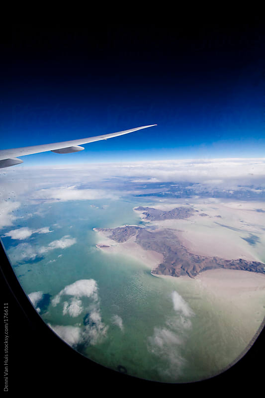 View of the coast out of airplane window. by Denni Van Huis for Stocksy United