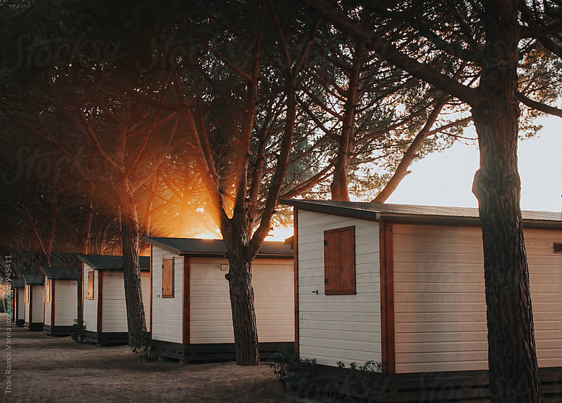sunset on a campsite by Thais Ramos Varela for Stocksy United