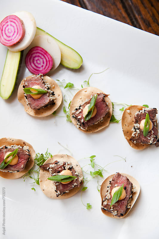Appetizers for a dinner party by Anjali Pinto for Stocksy United