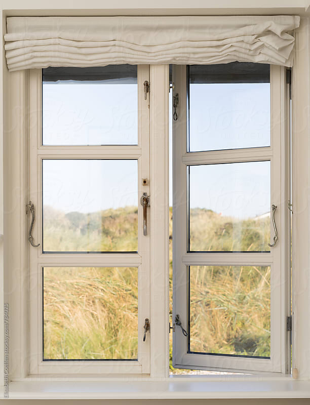 Open wooden window with a view of the dunes in Denmark by Elisabeth Coelfen for Stocksy United
