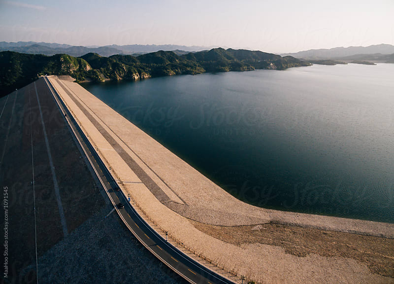 Aerial  view of reservoir dike by MaaHoo Studio for Stocksy United