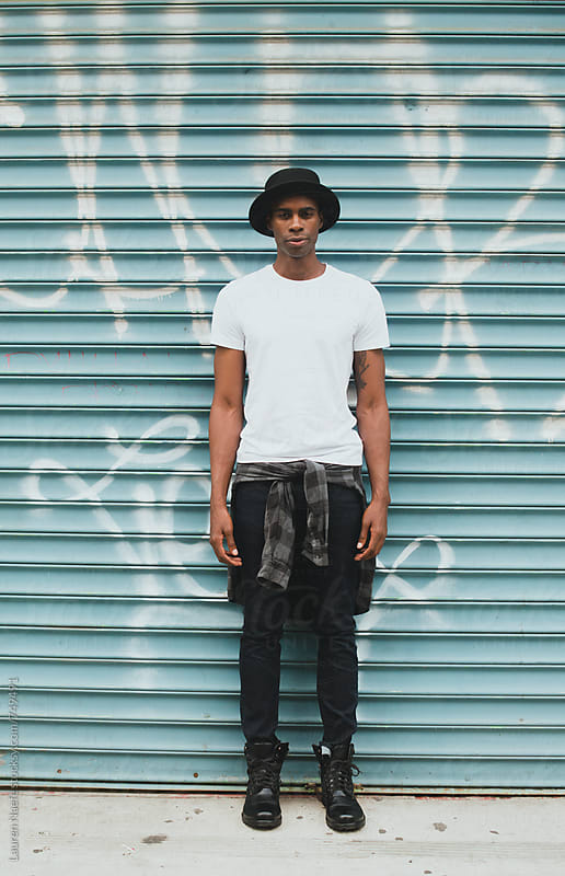 Portrait of young man in the city by Lauren Naefe for Stocksy United