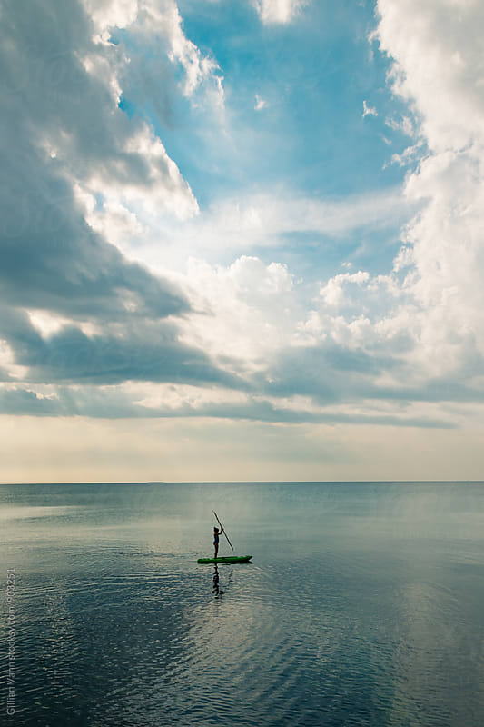 girl on kayak silhouetted by Gillian Vann for Stocksy United
