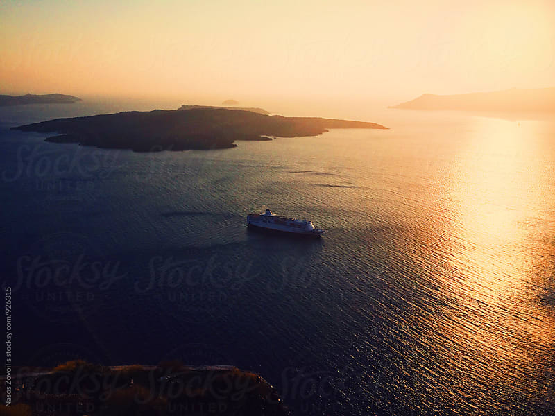 Oia sunset in Santorini, Cyclades, Greece by Nasos Zovoilis for Stocksy United