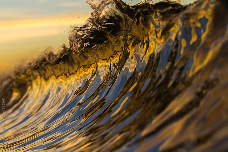 Sunrise Wave Reflection  by Nathan French for Stocksy United