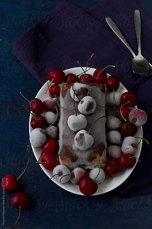 Ice cream cake with frozen cherries by Noemi Hauser for Stocksy United