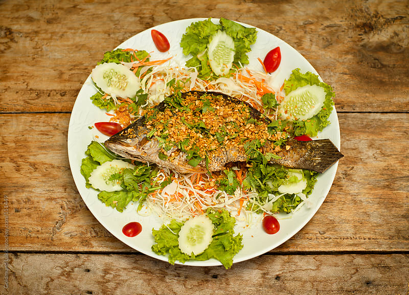 Fish Prepared in a Traditional Thai Style by Goldmund Lukic for Stocksy United