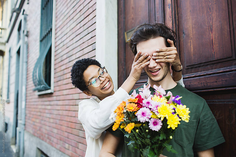 Young and happy couple on a date outdoors by michela ravasio for Stocksy United