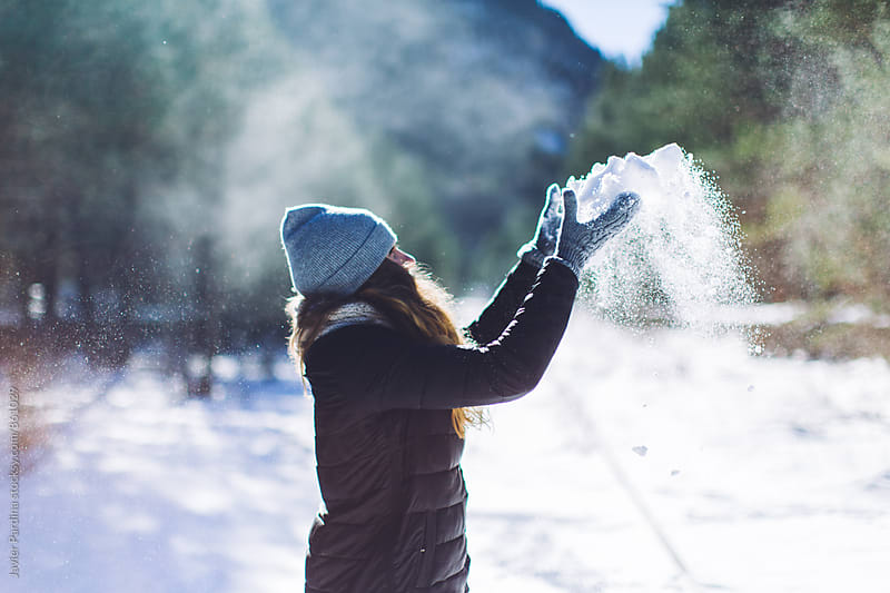 woman enjoying winter  by Javier Pardina for Stocksy United