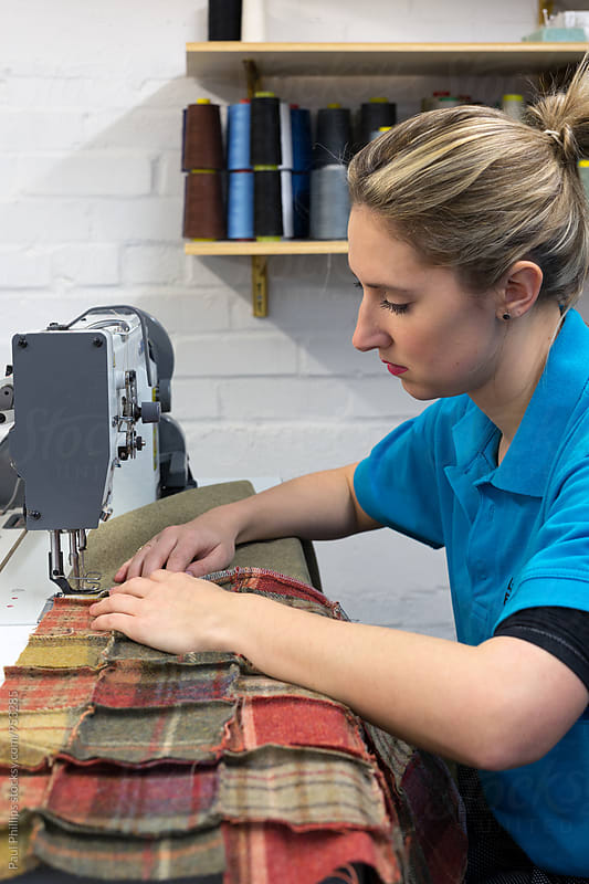 Machinist sewing in a furnishings company. by Paul Phillips for Stocksy United