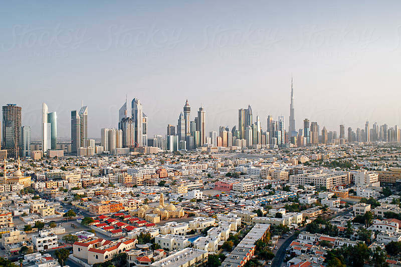 United Arab Emirates, Dubai, elevated view of the new Dubai skyline of modern architecture and skyscrappers including the Burj Khalifa on Sheikh Zayed Road by Gavin Hellier for Stocksy United