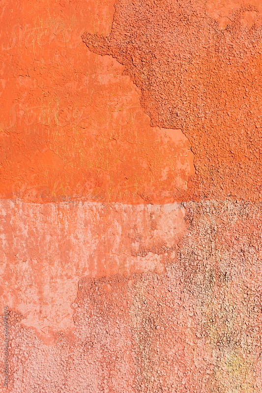 Shades of orange painted wall by Pixel Stories for Stocksy United
