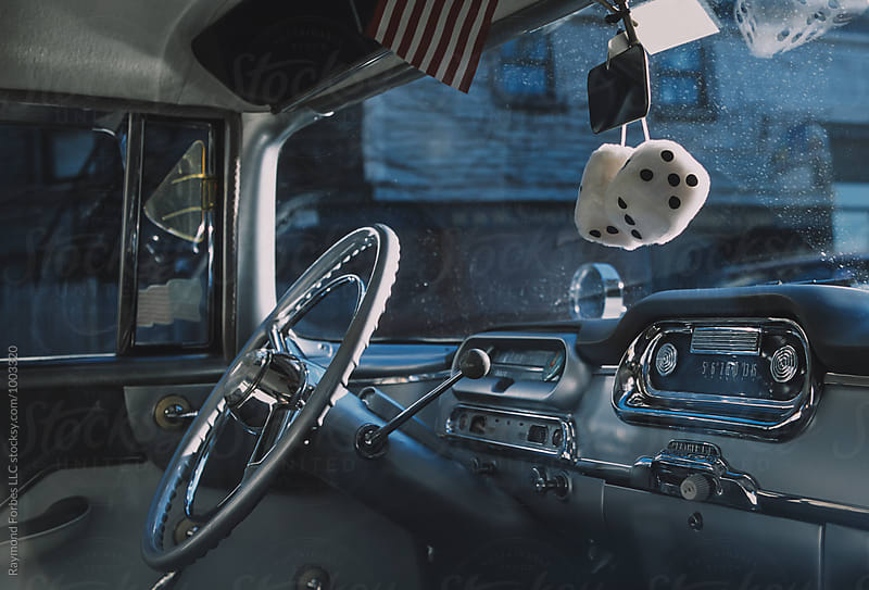 Antique American Car with fuzzy dice by Raymond Forbes LLC for Stocksy United