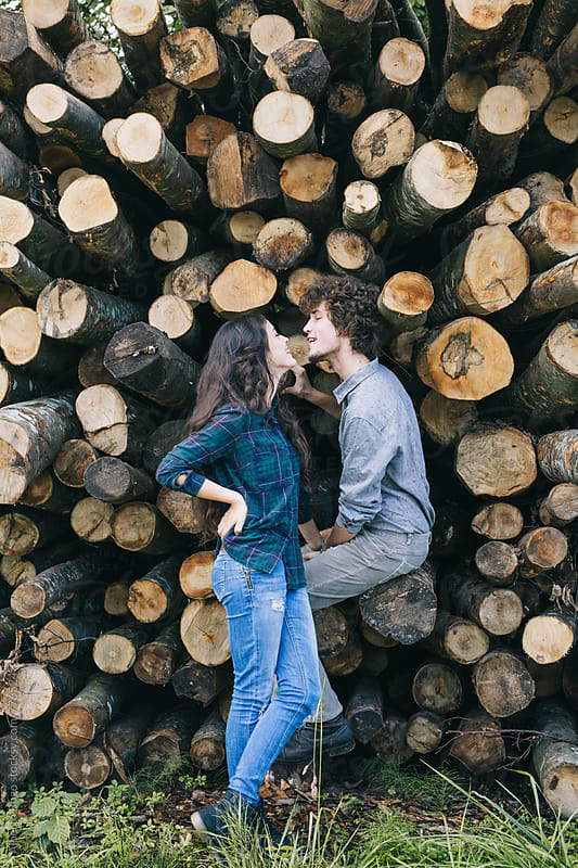 Young caucasian couple outdoor portrait. by Alberto Bogo for Stocksy United