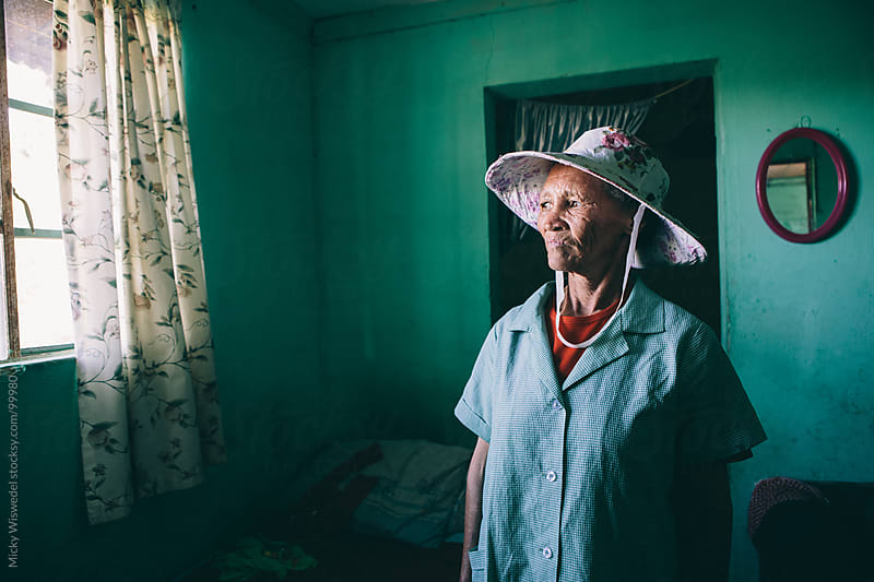 Portrait of a South African Domestica worker at home by Micky Wiswedel for Stocksy United