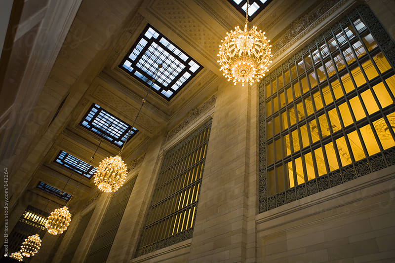 Chandelier Lighted Hall in New York Grand Central Terminal by Joselito Briones for Stocksy United