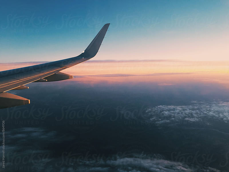 Sunset Through Airplane Window by Jared Harrell for Stocksy United
