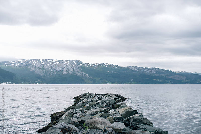 Stone pier in the sea by Tomas Mikula for Stocksy United