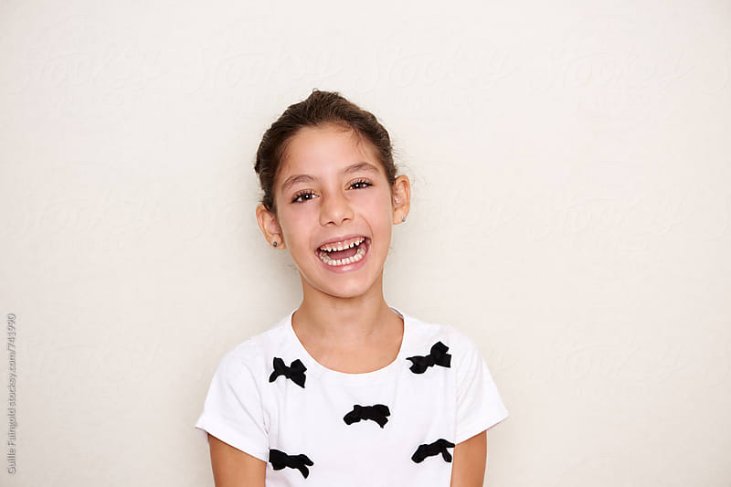 little girl laughing by Guille Faingold for Stocksy United