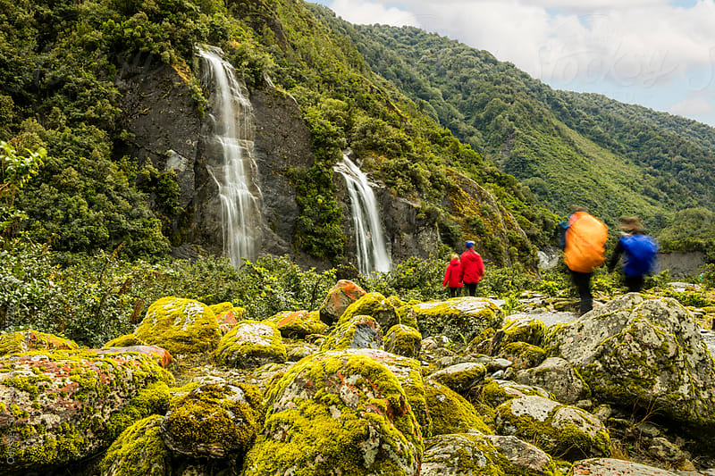 Hikers Backpacking By Waterfalls in New Zealand by Odyssey Stock for Stocksy United