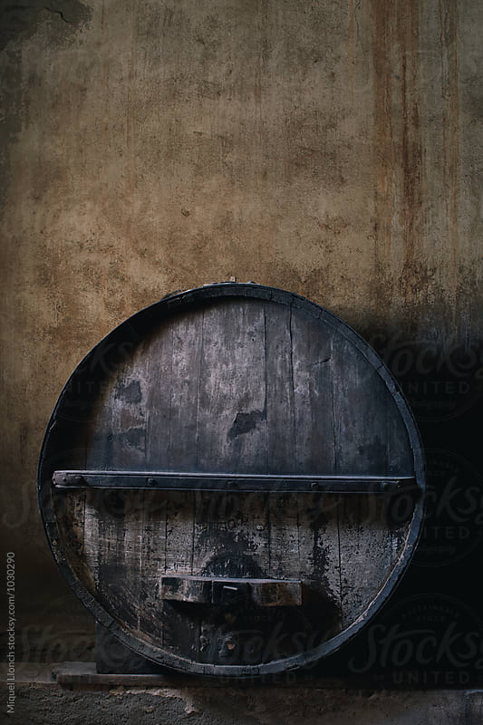 One old and big wine barrel by Miquel Llonch for Stocksy United