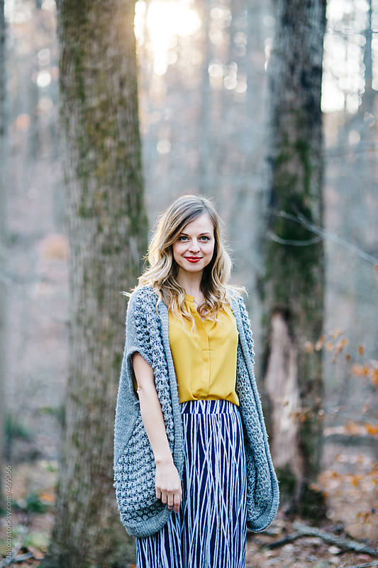 Fashionable and stylish woman standing in a forrest   by Jakob for Stocksy United