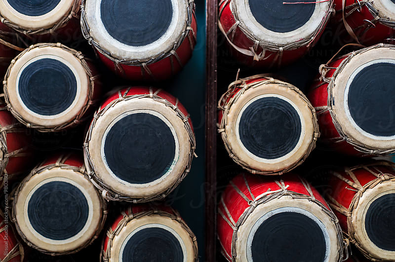 Nepali drums in a pile by Bisual Studio for Stocksy United
