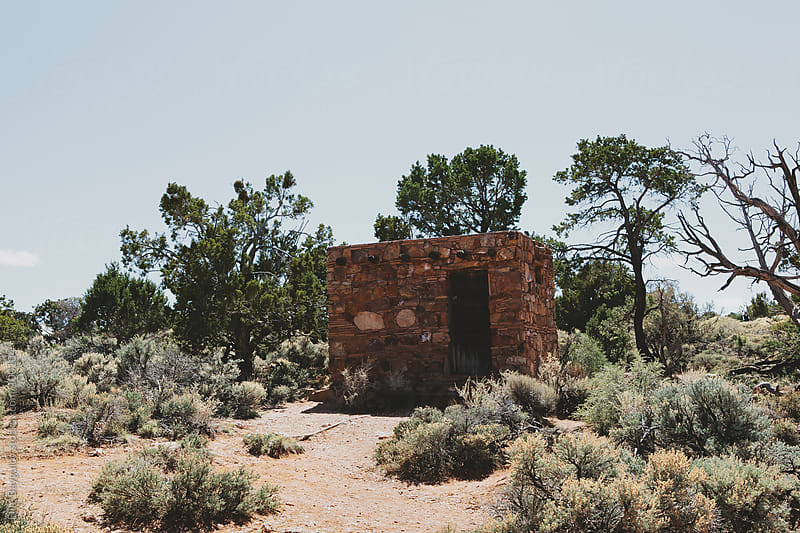 Stone shack in Arizona desert by Ellie Baygulov for Stocksy United