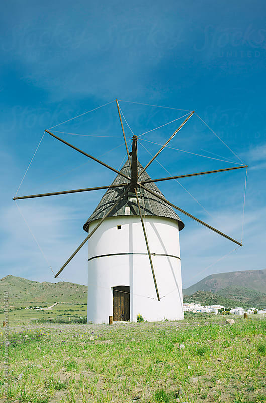 Windmill in Andalusia Spain by Blai Baules for Stocksy United