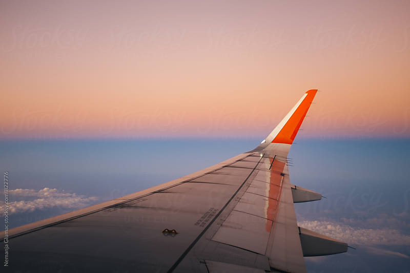 Beautiful Sunset through the Airplane Window by Nemanja Glumac for Stocksy United