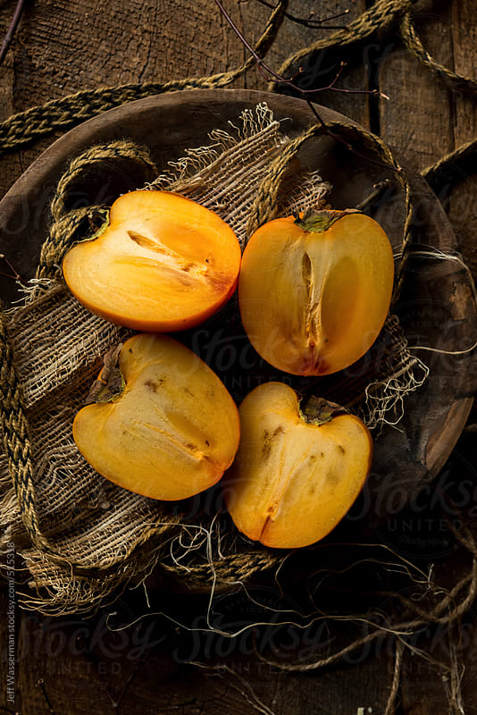 Sliced Persimmons in Rustic Setting by Studio Six for Stocksy United