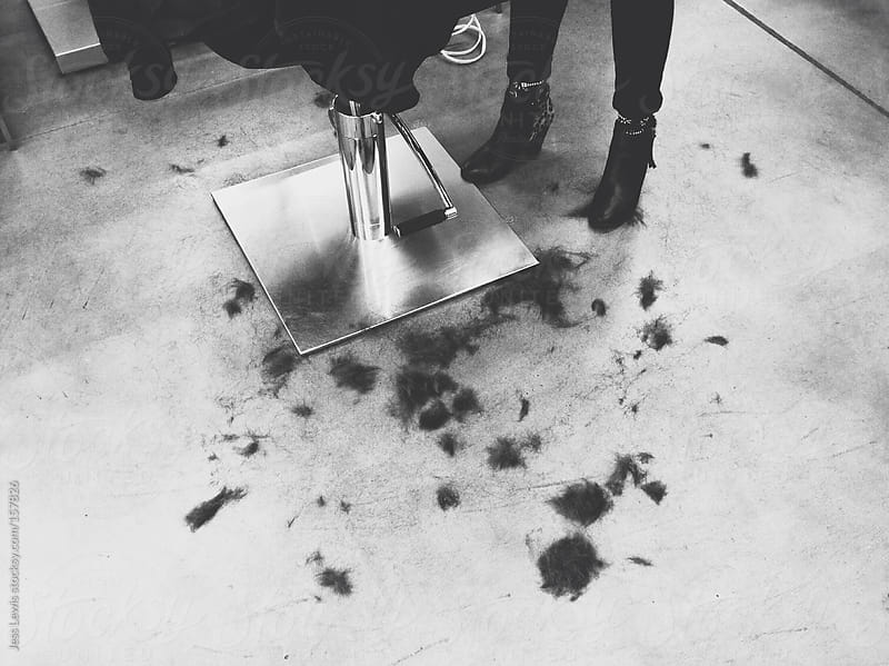 hair on floor of a salon by Jess Lewis for Stocksy United
